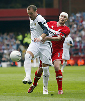 Photo: Chris Ratcliffe.<br /> Middlesbrough v West Ham United. The FA Cup, Semi-Final. 23/04/2006.<br /> Dean Ashton of West Ham clashes with Franck Queudrue of Middlesbrough
