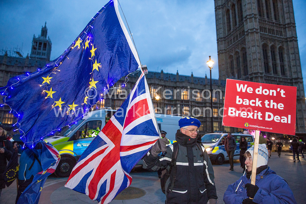London, UK. 13th March, 2019. Anti-Brexit activists from SODEM (Stand of Defiance European Movement) protest outside the Houses of Parliament on the evening of the vote on a 'No Deal' Brexit in the House of Commons.
