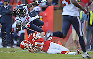 KANSAS CITY, MO - OCTOBER 20:  Quarterback Alex Smith #11 of the Kansas City Chiefs slides to the ground, after rushing for a first down, gets hit late by safety D.J. Swearinger #36 of the Houston Texans during the second half on October 20, 2013 at Arrowhead Stadium in Kansas City, Missouri.  Kansas City won 17-16. (Photo by Peter Aiken/Getty Images) *** Local Caption *** Alex Smith;D.J. Swearinger