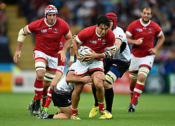 Nathan Hirayama of Canada is tackled in possession - Mandatory byline: Patrick Khachfe/JMP - 07966 386802 - 06/10/2015 - RUGBY UNION - Leicester City Stadium - Leicester, England - Canada v Romania - Rugby World Cup 2015 Pool D.