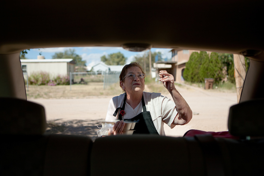 Bernis Chavez closes the hatch while holding meals to be delivered to Torrance County senior citizens. New Mexico has received more than $601,000 for senior meals programs around the state.