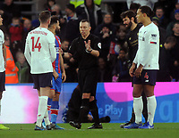 Football - 2019 / 2020 Premier League - Crystal Palace vs. Liverpool<br /> <br /> Referee Kevin Friend waits for VAR decision before disallowing Crystal Palace's goal, at Selhurst Park.<br /> <br /> COLORSPORT/ANDREW COWIE