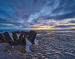 The Norwegian barque SS Nornen was wrecked on Berrow beach, Burnham on Sea, Somerset in 1897. The remains are still visible at low tide.
