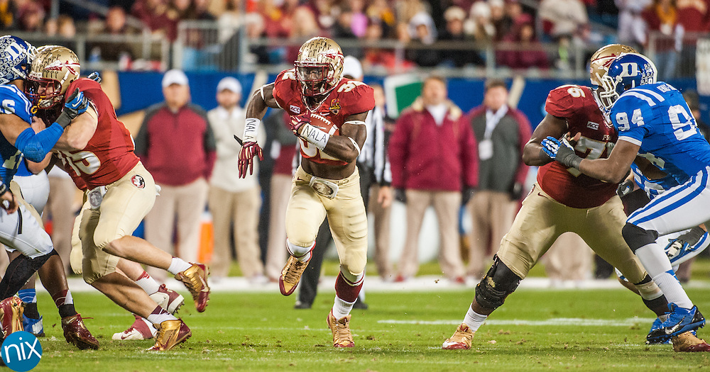 Florida State's James Wilder Jr. carries the ball against Duke during the ACC Championship game at Bank of America Stadium in Charlotte Saturday night. Florida State won the game 45-7.