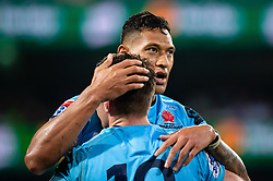 March 23, 2019 - Sydney, NSW, U.S. - SYDNEY, NSW - MARCH 23: Waratahs player Bernard Foley (10) congratulates Waratahs player Israel Folau (15) for his try at round 6 of Super Rugby between NSW Waratahs and Crusaders on March 23, 2019 at The Sydney Cricket Ground, NSW. (Photo by Speed Media/Icon Sportswire) (Credit Image: © Speed Media/Icon SMI via ZUMA Press)
