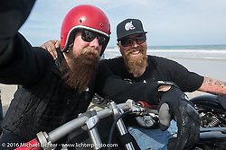 Bill Dodge (R) with Jim Root from the Band Slipknot, both on Bill's Blings Cycles bikes, on Daytona Beach during Daytona Bike Week 75th Anniversary event. FL, USA. Thursday March 3, 2016.  Photography ©2016 Michael Lichter.