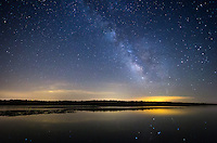 In the midst of a very rainy and cloudy summer, a night this clear was a rare treat. The milky way was reflected in Spring Lake, Illinois.