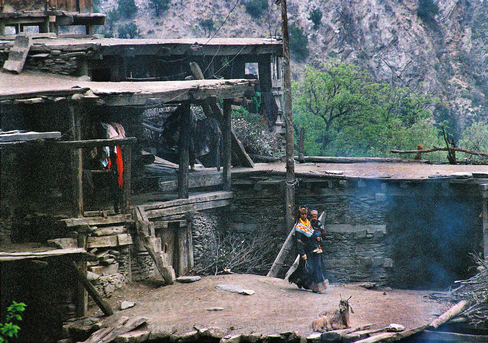 Pakistan, Northwest Frontier Province, 2004. Traditional building structures in the Kalash village of Birir. Each level utilizes common walls, floors and roofs, minimizing the use of materials necessary.