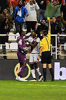 Rayo Vallecano´s Manucho and Malaga CF´s goalkeeper Idriss Carlos Kameni discuss while the referee Santiago Jaime Garcia shows a Yellow card to Manucho during 2014-15 La Liga match between Rayo Vallecano and Malaga CF at Rayo Vallecano stadium in Madrid, Spain. March 21, 2015. (ALTERPHOTOS/Luis Fernandez)