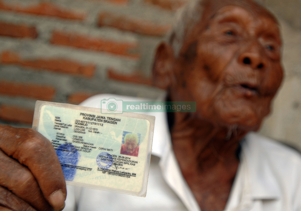 August 29, 2016 - Sragen, Central Java, Indonesia - An Indonesian man, named Mbah Gotho, claimed to be 146 years old, is the oldest human in world's history shows his identity card to press members at his family house in Sragen, Central Java, Indonesia on August 29, 2016. The civil registry office recorded parents born on December 31, 1870, age Mbah Gotho exceed men the oldest in the world that used to be held by French woman named Jeanne Calment lived to be 122 years old, his life Mbah Gotho have four wives and his last wife died in 1988. All of the children also had died and now his family is left ie, grandchildren, great-grandchildren, and great-great grandson. Dasril Roszandi  (Credit Image: © Dasril Roszandi/NurPhoto via ZUMA Press)
