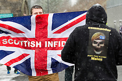 "© licensed to London News Pictures. Rochdale, UK  04/02/2012. The ""North West Infidels"", a Nationalist group splintered from the EDL; protest outside Rochdale Town Hall. About 150 turned out, many from Scotland. They shouted Nationalist, Islamophobic and anti-Zionist slogans and listed to speeches. Some gave Nazi salutes. Photo credit should read Joel Goodman/LNP"