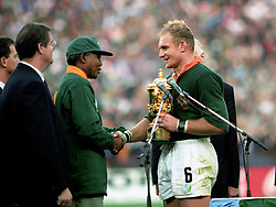 South Africa captain Francois Pienaar receives the William Webb Ellis Trophy from Nelson Mandela