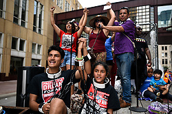 """James Gutierrez, 15, and his sister, Lilah, 8, wear chains during a demonstration against the Trump administration's immigration policies on Saturday, June 30, 2018, in downtown Minneapolis, MN, USA. """"We're here to stop them (children) from being put in cages,"""" said James. On Trump's executive order to stop the separations, he says """"That just means they're all going to be put in the cage together."""" Photo by Aaron Lavinsky/Minneapolis Star Tribune/TNS/ABACAPRESS.COM"""