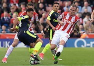 Glenn Whelan of Stoke city battles with Francis Coquelin of Arsenal. Premier league match, Stoke City v Arsenal at the Bet365 Stadium in Stoke on Trent, Staffs on Saturday 13th May 2017.<br /> pic by Bradley Collyer, Andrew Orchard sports photography.