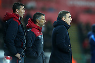 Swansea city assistant coaches Bruno Lage (l) and Joao Mario © stand on the touchline alongside Swansea city manager Carlos Carvalhal (right) during the Premier league match, Swansea city v Tottenham Hotspur at the Liberty Stadium in Swansea, South Wales on Tuesday 2nd January 2018. <br /> pic by  Andrew Orchard, Andrew Orchard sports photography.