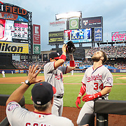 NEW YORK, NEW YORK - July 07: Bryce Harper #34 of the Washington Nationals is congratulate on hitting a solo home run in the fourth inning as he returns to the dugout during the Washington Nationals Vs New York Mets regular season MLB game at Citi Field on July 07, 2016 in New York City. (Photo by Tim Clayton/Corbis via Getty Images)