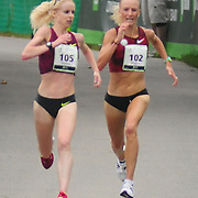 SOUTH PORTLAND, Maine -- 8/2/14<br /> top women, Gemma Steel, left, and Shalene Flanagan sprint to the finish to be the first and second place female finishers at Saturday's Beach to Beacon road race. <br /> <br /> The Beach to Beacon, a 10k road race through the streets of Cape Elizabeth and South Portland Maine, brought world class athletes together with more than 2000 runners from all over the world. Weather was humid and grey, but the rain mostly held off through the day.  Photo  ©2014 by Roger S. Duncan