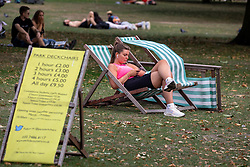 © Licensed to London News Pictures. 19/09/2020. London, UK. A sunbather enjoys the warm sunshine on the first weekend of the Rule of Six as Police patrol Hyde Park in London. Gatherings of over six people have now been banned by the Government after a spike in coronavirus cases. Prime Minister Boris Johnson announced yesterday that the UK was heading for a second wave with the North East already under lockdown.  Photo credit: Alex Lentati/LNP