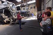 Strasshof, Austria.<br /> Triebwagentage (railcar days) at Das Heizhaus - Eisenbahnmuseum Strasshof, Lower Austria's newly designated competence center for railway museum activities.<br /> Curator Rupert Gansterer (red polo shirt) guiding visitors around.
