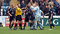 Photo: Leigh Quinnell.<br /> Coventry City v Leeds United. Coca Cola Championship. 18/03/2006. Referee C.Oliver steps between the players after a fight breaks out.