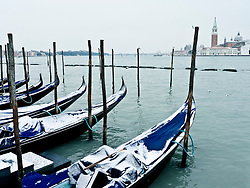 Winter view of gondolas berthed near San Marco in Venice Italy