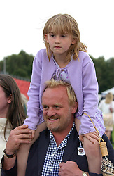 Chef ANTONY WORRALL THOMPSON and his daughter BILLIE at the 2004 Cartier International polo day at Guards Polo Club, Windsor Great Park, Berkshire on 25th July 2004.