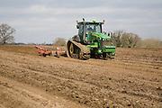 John Deere 8345RT tracked tractor working in a field, Suffolk, England