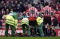 Photo. Glyn Thomas.<br /> Sunderland v West Bromwich Albion. <br /> Nationwide Division 1. 18/04/2004.<br /> Sunderland's captain George McCartney is stretchered off.