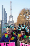 January, 21st, 2017 - Paris, Ile-de-France, France: Women protesters dressed as Statue of Liberty with Eiffel Tower and police. Thousands of protesters in Paris join anti-Trump Women's March around the world.