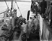"""31/08/1953<br /> 08/31/1953<br /> 31 August 1953 <br /> Rescue at sea by trawler """"Uncle Pat"""" of three Co. Dublin men who spent a night in a row boat at Dun Laoghaire. As the trio prepare to make their way ashore the cameramen stand ready!"""