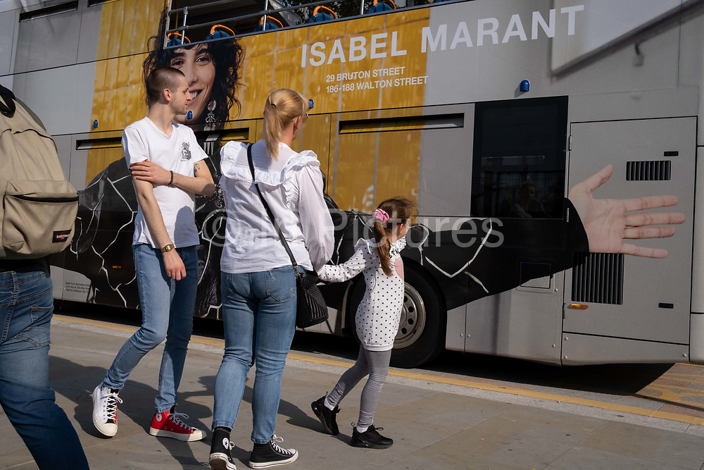 An ad for the luxury fashion and accesssory brand Isabel Marant, is on the rear and side panels of a London tour bus with the Golden Tours company and part of campaign to be seen in front of the public across the capital, on 19th September 2020, in London, England.