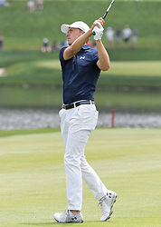 June 24, 2018 - Cromwell, CT, U.S. - CROMWELL, CT - JUNE 24: Jordan Spieth takes a shot from the fairway during the Final Round of the Travelers Championship on June 24, 2018 at TPC River Highlands in Cromwell, CT (Photo by Joshua Sarner/Icon Sportswire) (Credit Image: © Joshua Sarner/Icon SMI via ZUMA Press)