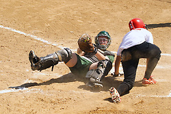 05 April 2008: Kelly Nelson puts the tag on Kelsey Epping at the plate. The Carthage College Lady Reds lost the first game of this double header to the Titans of Illinois Wesleyan 4-1 at Illinois Wesleyan in Bloomington, IL