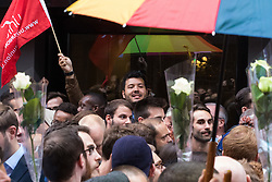 "Old Compton Street, Soho, London, June 13th 2016. Thousands of LGBT people and their friends converge on Old Compton Street in London's Soho to remember the fifty lives lost in the attack on gay bar Pulse in Orlando, Florida. PICTURED: A man leads chants proclaiming ""we are not afraid""."