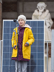 © Licensed to London News Pictures. 28/02/2020. Bristol, UK. Environmental activist GRETA THUNBERG speaks on stage at the Youth Strike 4 Climate to many thousands of people outside Bristol City Hall on College Green followed by a march through the city centre. Greta Thunberg started the Youth Strike 4 Climate protest movement in her home country of Sweden when she sat alone outside the Swedish parliament, eventually paving the way for the Fridays for Future movement across the world. Thousands of people are expected to attend the event in Bristol with many roads closed in the city centre. In 2018 Bristol was the first city to declare a climate emergency and also the first to declare an ecological emergency just four weeks ago. Photo credit: Simon Chapman/LNP.