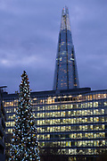 Christmas tree lights compliments lighting on in buildings and The Shard skyscraper in London, England, United Kingdom.