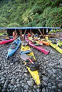 Kayakers at Hakaano, North Shore, Molokai, Hawaii.
