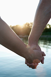 Close-up of couple in love holding hands during sunset, Bavaria, Germany