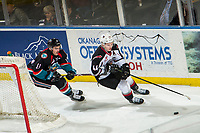 KELOWNA, CANADA - NOVEMBER 28:  Erik Gardiner #11 of the Kelowna Rockets stick checks Bowen Byram #44 of the Vancouver Giants as they skate for the puck from behind the net during first period on November 28, 2018 at Prospera Place in Kelowna, British Columbia, Canada.  (Photo by Marissa Baecker/Shoot the Breeze)