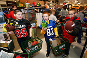 Corporate Event and Promotional Marketing Photographer in Kansas City - Kansas City Chiefs players, Travis Kelce, Charcandrick West and Dontari Poe accompany members of a Football Club as they shop for items on their wish list at the Sports Matter Holiday Shopping event hosted by DICK'S Sporting Goods  in Leawood, Kansas. Photo by Colin E. Braley for Dick's Sporting Goods