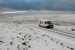 © Licensed to London News Pictures. 21/01/2021. Rhayader, Powys, Wales, UK. A courier drives in treacherous conditions on a mountain road in the Elan Valley near Rhayader, Powys, UK. after overnight snow fell in Powys, Wales, UK. Photo credit: Graham M. Lawrence/LNP
