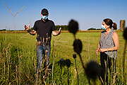 27 AUGUST 2020 - LACONA, IOWA: JUSTIN JORDAN and THERESA GREENFIELD look at restored prairie on the Jordan Farm Thursday. Greenfield, a Democrat, is running against Republican US Senator Joni Ernst to represent Iowa in the US Senate. Greenfield toured the Jordan Farm in Lacona and talked about her rural policies, including plans to bring hi speed internet to rural areas.    PHOTO BY JACK KURTZ