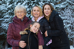 Tunbridge Wells, December 16 2017. Winner of the TK Maxx White Christmas promotion enjoy a day of fun in the snow, after aunt Helen Haggertay found one of the 'snow globes' in TK Maxx in Tunbridge Wells and gifted it to her sister Louise and niece Sofia Migliaccio. An exciting day ensued after several tons of snow were delivered BY TK Maxx and friends arrived to enjoy the day. PICTURED: Nana Yvonne Kempton poses with her daughters Helen and Louise and grandaughter Sofia, 9.