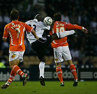 Photo: Steve Bond.<br />Derby County v Blackpool. Carling Cup. 28/08/2007. Darren Moore (L) and Scott Vernon (R) Tangle