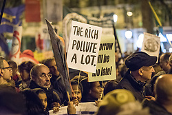 6 December 2019, Madrid, Spain: 'Rich people pollute a lot' reads a sign, as thousands upon thousands of people march through the streets of central Madrid as part of a public contribution to the United Nations climate meeting COP25, urging decision-makers to take action for climate justice.