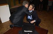 Eddie Jordan and Michael Douglas. Celebrity Possesions auction. to raise funds for CLIC. Cancer and Leukaemia in Childhood's London Home from Home 2001 appeal. Christie's 22 October 2001. © Copyright Photograph by Dafydd Jones 66 Stockwell Park Rd. London SW9 0DA Tel 020 7733 0108 www.dafjones.com