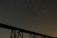 Salisbury Mills, New York  - Stars, including the constellation Orion, shine above the Moodna Viaduct railroad trestle on the night of Sept. 29, 2013.
