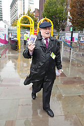 "© Licensed to London News Pictures. 01/10/2012. Manchester, UK . John Prescott arrives at the venue waving a "" Titanic "" card . Labour Party Conference Day 2 at Manchester Central . Photo credit : Joel Goodman/LNP"