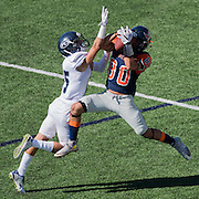 (date)(time) -- Orang Coast College wide receiver Cedric Williams (80) jumps to receive a pass during the first quarter of a CCCAA football game defended by Fullerton College defensive back Andrae Pierman (15) in Costa Mesa, CA -- Photo by Colter Peterson, Sports Shooter Academy