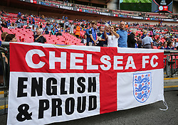 Chelsea's fans unfurl a banner before the match against Arsenal